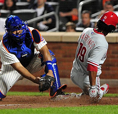 Michael Martinez slides home safely as part of the Phillies' ninth-inning rally off Francisco Rodriguez.  (US Presswire)
