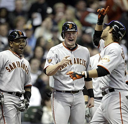The Giants' Brandon Crawford (far right) connects on a go-ahead grand slam in his first major-league game.  (AP)