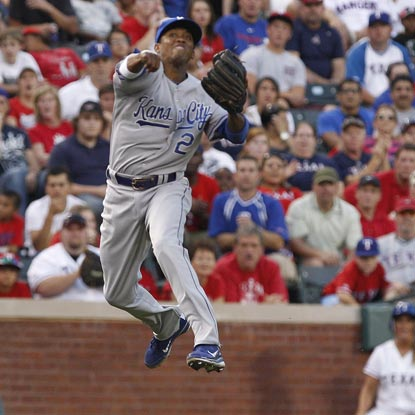 Alcides Escobar comes up big with the glove to help the Royals top the Rangers in a 14-inning marathon.  (Getty Images)
