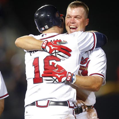 Chipper Jones celebrates with teammate Brian McCann after driving in the winning run in the 12th inning.   (Getty Images)