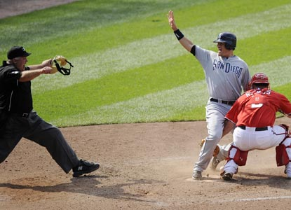 With the game tied at four, Jorge Cantu breaks an 0-for-13 slump before scoring the winning run on a Ryan Ludwick ground ball.  (AP)