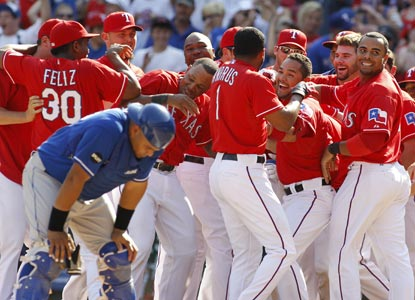 Elvis Andrus (1) celebrates with teammates after smacking in the game-winning run in the bottom of the ninth. (Getty Images)