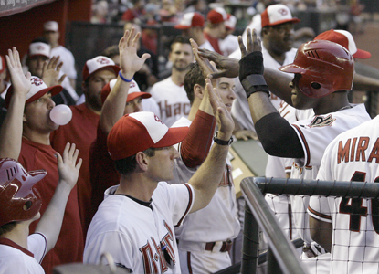 Justin Upton (right) ties a career best at the plate by going 5-for-5 to help the D-Backs rout the Marlins in epic fashion. (AP)