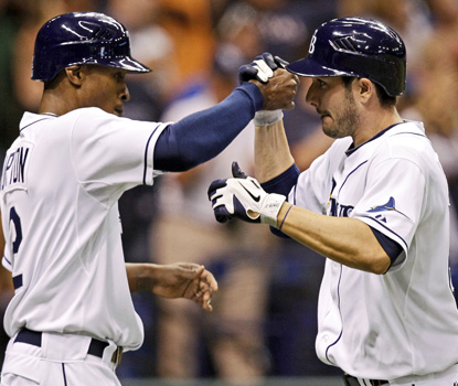 The Rays' Matt Joyce (right) accepts congratulations from B.J. Upton after his two-run homer. (AP)