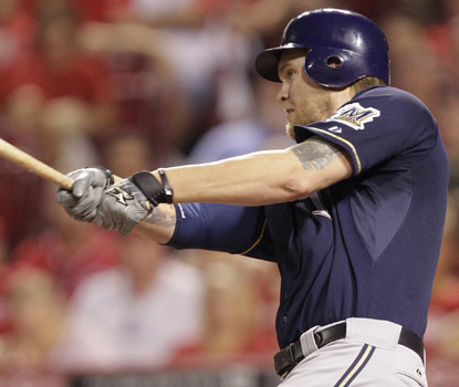 Corey Hart drives in a run in the seventh inning, one of his four RBI in the Brewers win over the Reds. (AP)