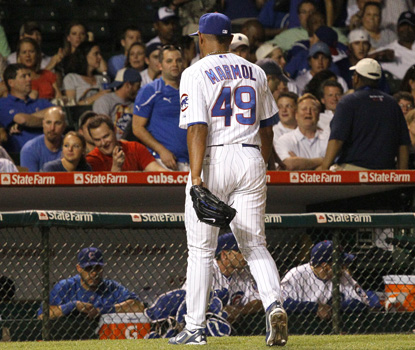 Cubs' reliever Carlos Marmol leaves the game after blowing his third save of the season. (AP)