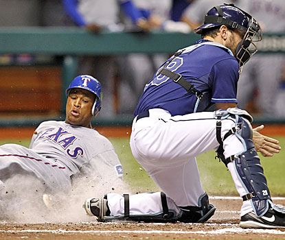 Adrian Beltre beats the throw to Rays catcher John Jaso to score the Rangers' first run of the series finale.  (AP)