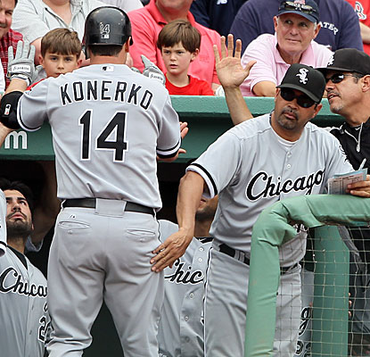 Paul Konerko gets a congratulatory pat on the backside from Ozzie Guillen after his mammoth ninth-inning home run.  (Getty Images)