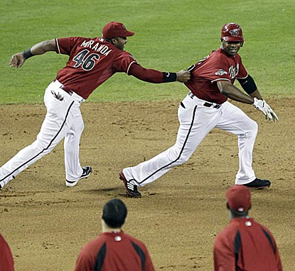 The walk-off chase is on in Phoenix, and first baseman Juan Miranda is the first to get to Diamondbacks hero Justin Upton.  (AP)
