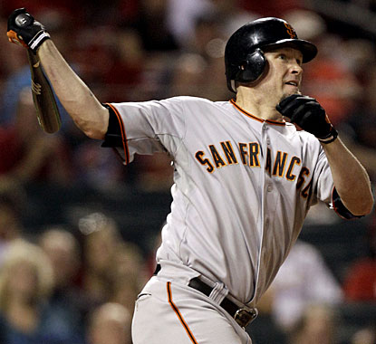 Aubrey Huff caps his big hitting night with a two-run homer in the ninth inning for San Francisco. (AP)