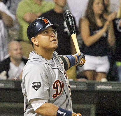Miguel Cabrera, who watches the ball leave the park, hits a two-run shot to break a tie with two outs in the ninth inning. (AP)