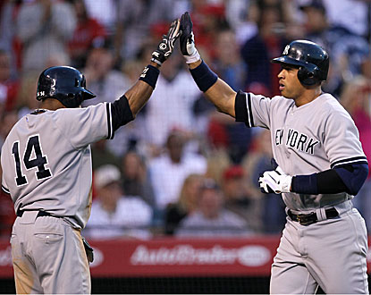 Alex Rodriguez (right) high-fives Curtis Granderson after hitting a two-run homer in the sixth inning. (Getty Images)