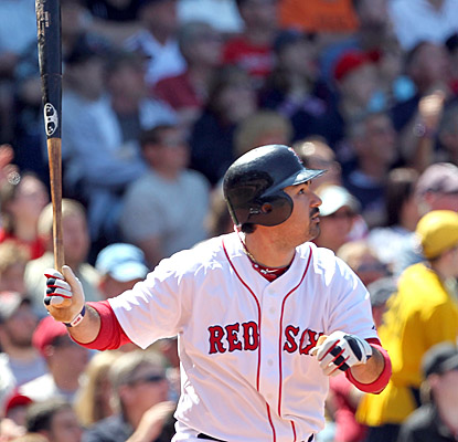 Adrian Gonzalez, who watches as his two-run shot leaves the park, helps the Red Sox sweep the A's. (Getty Images)