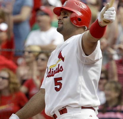 Albert Pujols watches his ball sail over the fence in the 10th inning, his third home run in two games.  (AP)