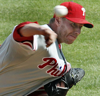 Roy Halladay has an efficient day on the mound and also contributes on offense by getting on base twice and scoring once. (AP)