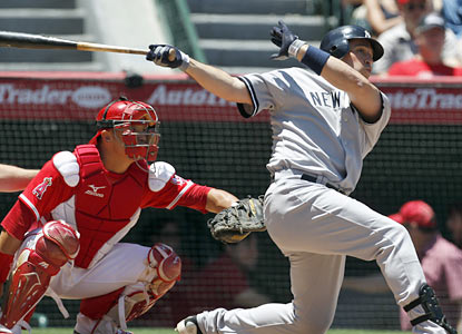 Mark Teixeira hurts his former team by going yard twice. The Yankees 1B finishes with three hits and three RBI. (AP)