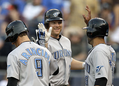 Adam Lind (center) is greeted by teammates in the first inning after he connects on his 10th homer of the season.  (AP)