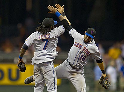Batting hero Jose Reyes and center fielder Angel Pagan celebrate after the Mets pull out a tight road victory.  (US Presswire)