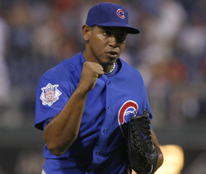 Carlos Marmol celebrates the final out, earning his 12th save in 16 chances this season. (AP)