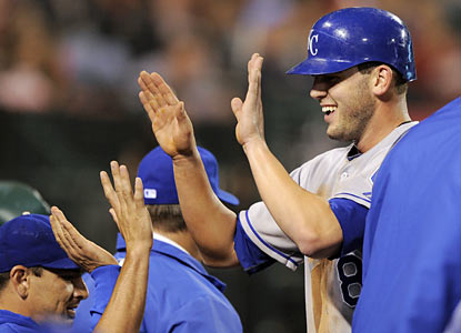 Not a shabby debut for Royals rookie Mike Moustakas, who finishes with a single, a walk and a run.  (AP)