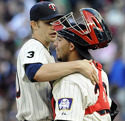 Scott Baker and catcher Rene Rivera celebrate a five-hit complete game for the resurgent Twins.  (AP)