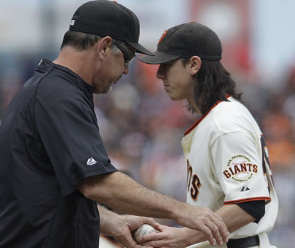 Giants manager Bruce Bochy makes a pitching change as Tim Lincecum fails to get out of the fifth inning vs. the Reds. (AP)