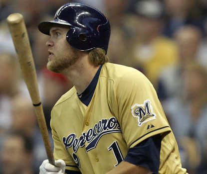 Corey Hart delivers a two-run double in the sixth inning, part of a four-run Brewers outburst. (AP)