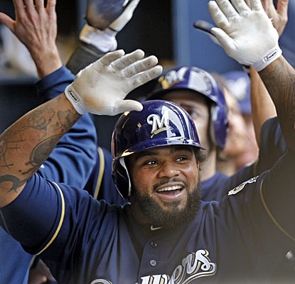 Prince Fielder high-fives his Brewers teammates after hitting his 19th home run in the sixth inning vs. the Cardinals. (AP)