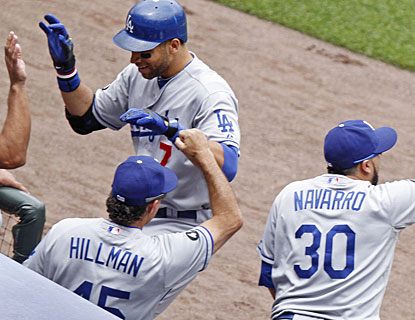 James Loney gets cheers from the bench after smacking a grand slam, the second of his career. (AP)
