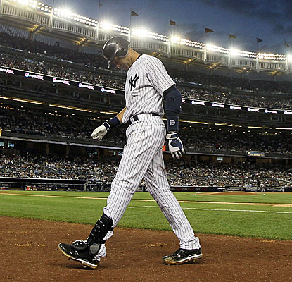 Derek Jeter limps back to the Yankee dugout after flying out in the fifth against the Indians. (Getty Images)