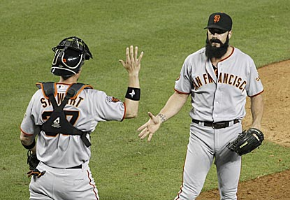 Brian Wilson has an adventurous ninth inning before finishing it with a strikeout and a handshake from catcher Chris Stewart.  (AP)