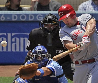 Scott Rolen pounds one of his three hits on the afternoon on the way to racking up three RBI for Cincinnati.  (AP)