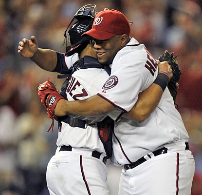 Livan Hernandez embraces Pudge Rodriguez after hurling his ninth career shutout.  (US Presswire)