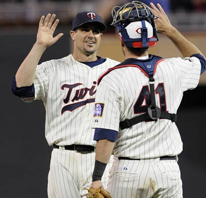 Carl Pavano moves to 2-0 with a 1.44 ERA in his last three games as the Twins win their 10th in 12 games.  (AP)