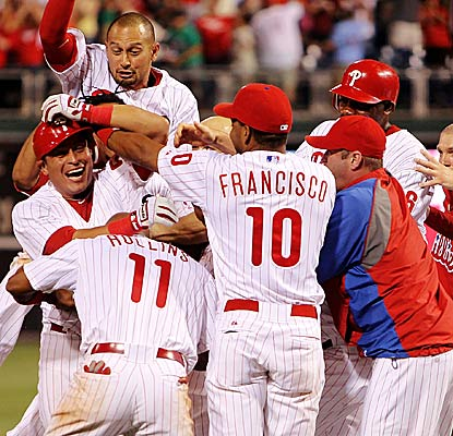 The Phillies mob Carlos Ruiz following his  two-out, game-winning hit in the 10th inning.  (Getty Images)