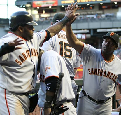 Pablo Sandoval returns to the dugout after scoring a run and helping the Giants give Madison Bumgarner rare run support.  (Getty Images)