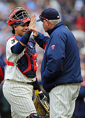 Manager Ron Gardenhire, high-fiving Rene Rivera, says the Twins 'haven't been able to put our team on the field since day one.' (Getty Images)