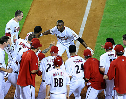 Teammates congratulate Justin Upton after he hit a home run in the 10th inning to give the Diamondbacks a win over the Giants.  (Getty Images)