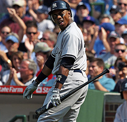 Curtis Granderson and the Yankees have a rough afternoon at Wrigley against Cubs starter Doug Davis.  (Getty Images)