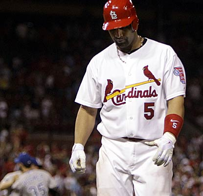 A dejected Albert Pujols walks off the field after grounding out to end the game.  (AP)