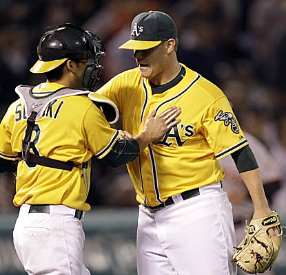 Kurt Suzuki and Andrew Bailey are more than happy to end Oakland's six-game skid against their Bay Area rivals.  (AP)