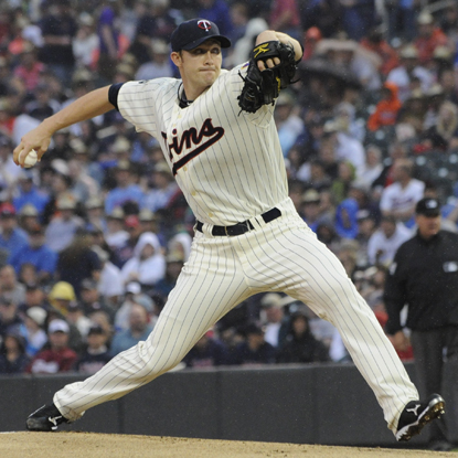 Scott Baker strikes out 10 during eight dominant innings while leading the Twins to a shutout victory over the Padres.  (Getty Images)