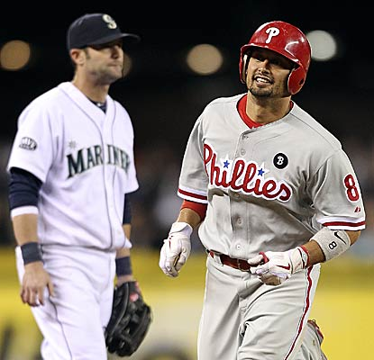 Philadelphia's Shane Victorino collects a season-high four RBI and falls a single short of the cycle.  (Getty Images)
