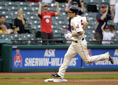 Cord Phelps smacks his first major league HR in the 11th, a three-run shot that gives the Indians a victory.  (AP)