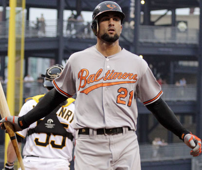 With three hits, Nick Markakis extends his hitting streak to 11 games in Baltimore's victory. (AP)