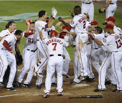 Washington's Wilson Ramos (3) is mobbed after hitting a game-winning, three-run homer vs. Seattle. (AP)