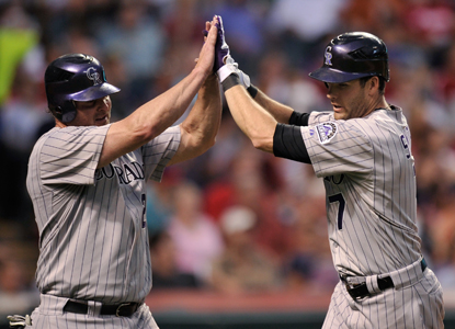 Seth Smith's (right) second HR of the night snaps a ninth-inning tie at the expense of Cleveland's Chris Perez.  (Getty Images)