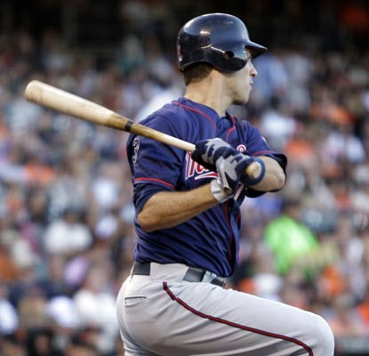 Twins batters set a major league record with eight consecutive hits in the first inning against Madison Bumgarner. (AP)