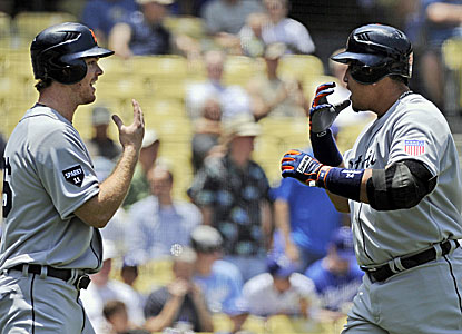 Miguel Cabrera (right) celebrates his two-run shot with teammate Brennan Boesch. (AP)
