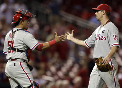 Phillies catcher Carlos Ruiz congratulates Cliff Lee on his second straight complete-game shutout. (AP)